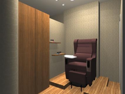 個室のフットブースでお客様に施術します。